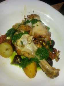 a roast chicken dish with potatoes and a cacciatore type of sauce